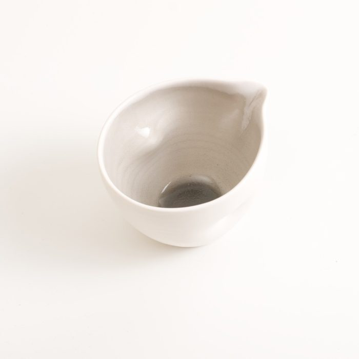 Handmade porcelain pouring bowl small grey dimpled. Small or medium size with tactile dimples instead of handles. Inside glazed in pale blue, turquoise, pink or grey. Ideal for sauces, gravy, hummus or mayonnaise.