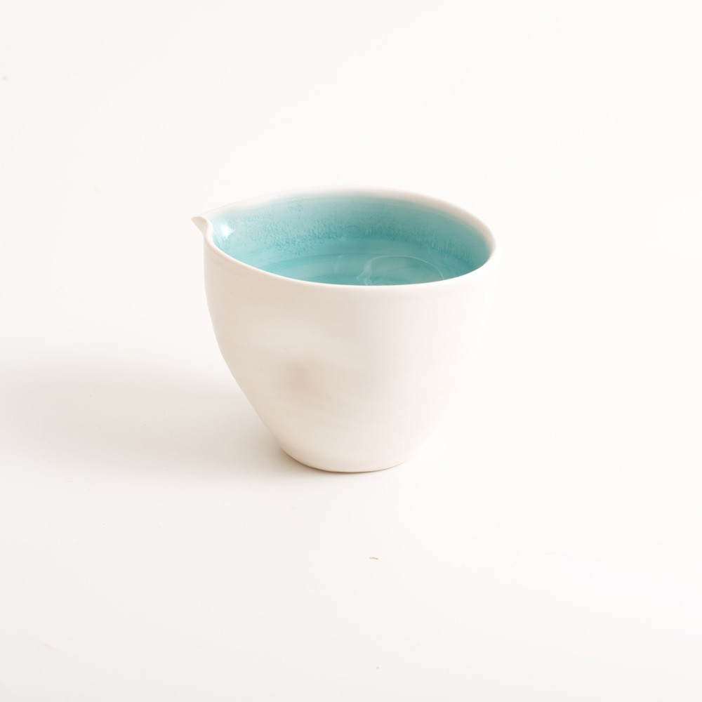Handmade porcelain pouring bowl small turquoise. Choice of mall or medium size with tactile dimples instead of handles. Inside glazed in pale blue, turquoise, pink or grey.