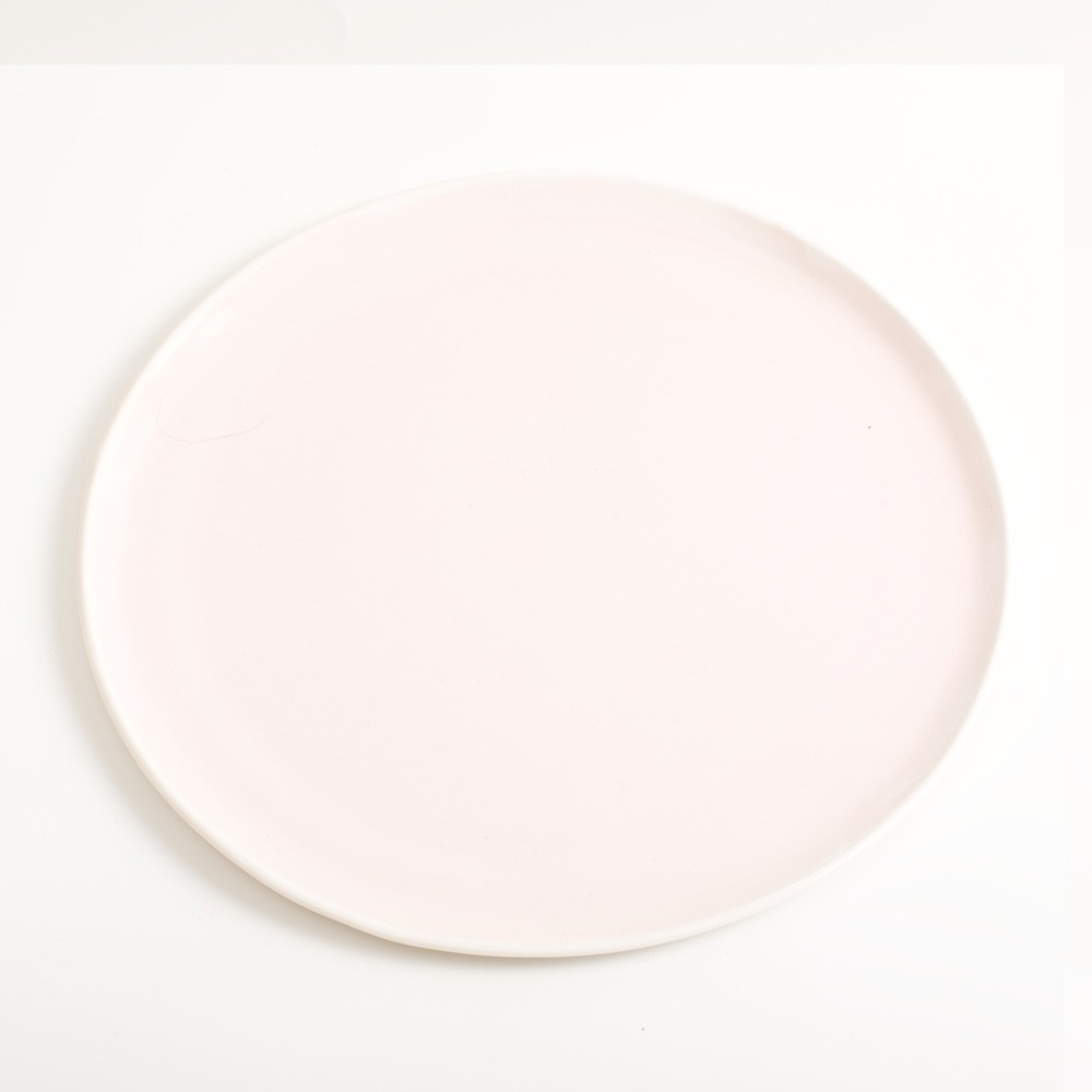 Handmade medium pink porcelain plate. Made in 3 sizes 5 colours. Hand thrown in England, dishwasher safe. These look great as part of a mix and match set. For every day dining and entertaining.