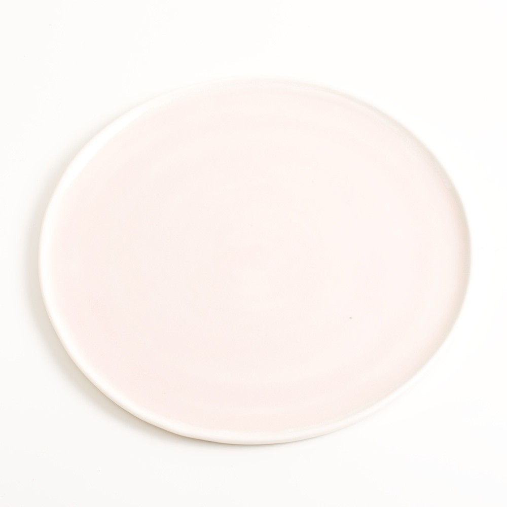 Handmade pink small porcelain plate. Made in 3 sizes 5 colours. Hand thrown in England, dishwasher safe. These look great as part of a mix and match set. For every day dining and entertaining.