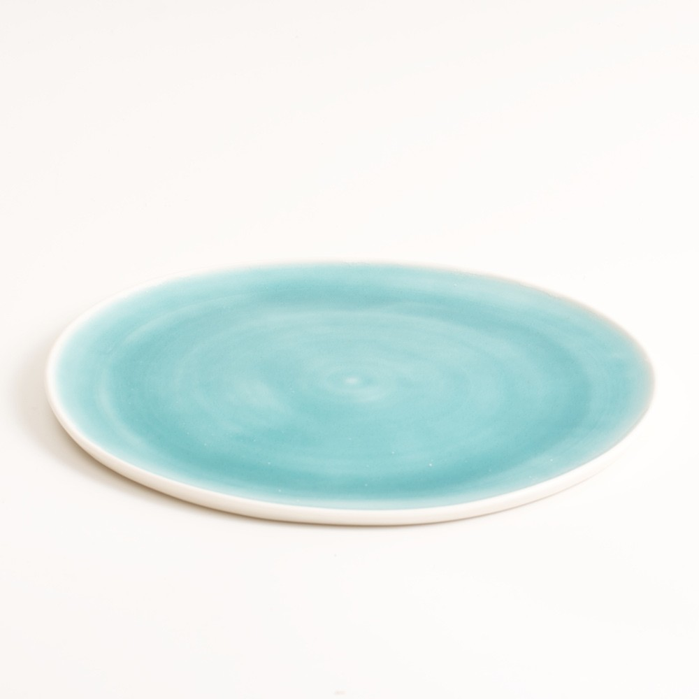 Small handmade porcelain plate blue. Available in 3 sizes 5 colours. Hand thrown in England, dishwasher safe. These look great as part of a mix and match set. For every day dining and entertaining.