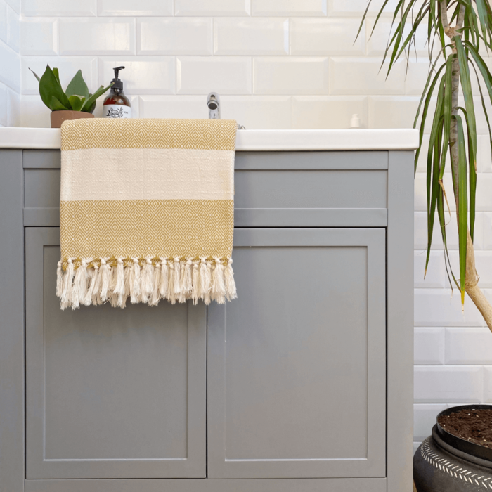 Colourful baby blankets, throws, towels or sarongs in ethical and soft Turkish cotton. Ready to wrap around yourself or a loved one. GOTS certified organic cotton. 170 x 90cm Seen here in pickle.