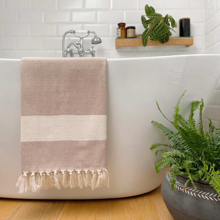 Colourful baby blankets, throws, towels or sarongs in ethical and soft Turkish cotton. Ready to wrap around yourself or a loved one. GOTS certified organic cotton. 170 x 90cm Seen here in putty.