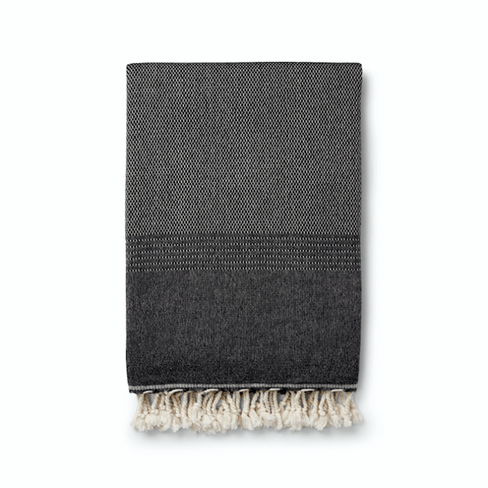 Ekin peshtemal hammam towel in black. Other colours available at chalkandmoss.com. Perfect for the beach, on journeys or as a bathroom towel.
