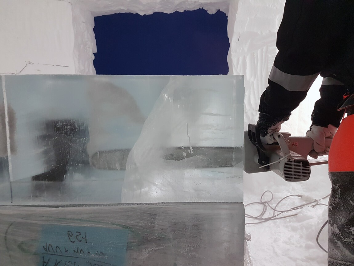 Clear as ice, literally. Cutting ice blocks, building the structure at ICEHOTEL Sweden