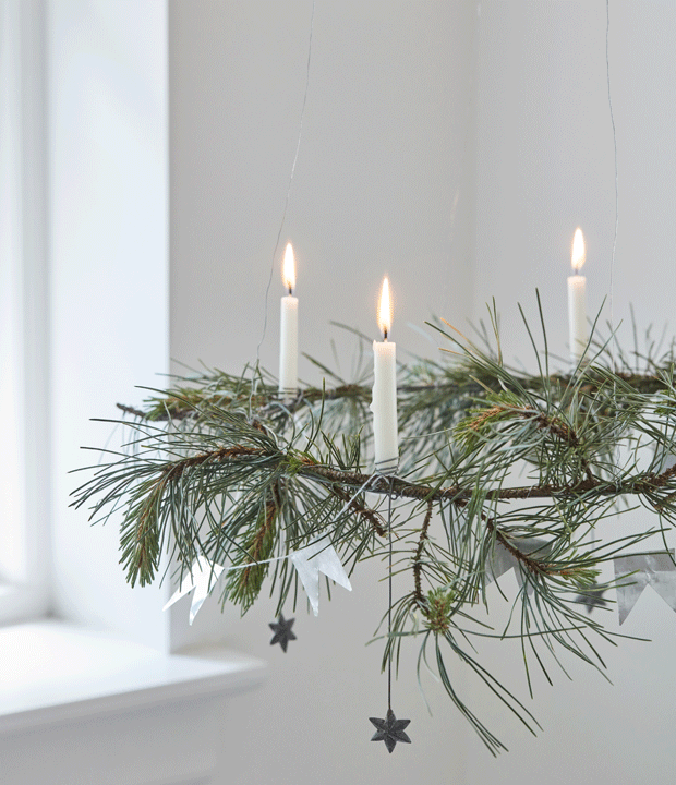 Soft light from this hanging advent candle. Green and white are a beautiful natural colour combination for Christmas.