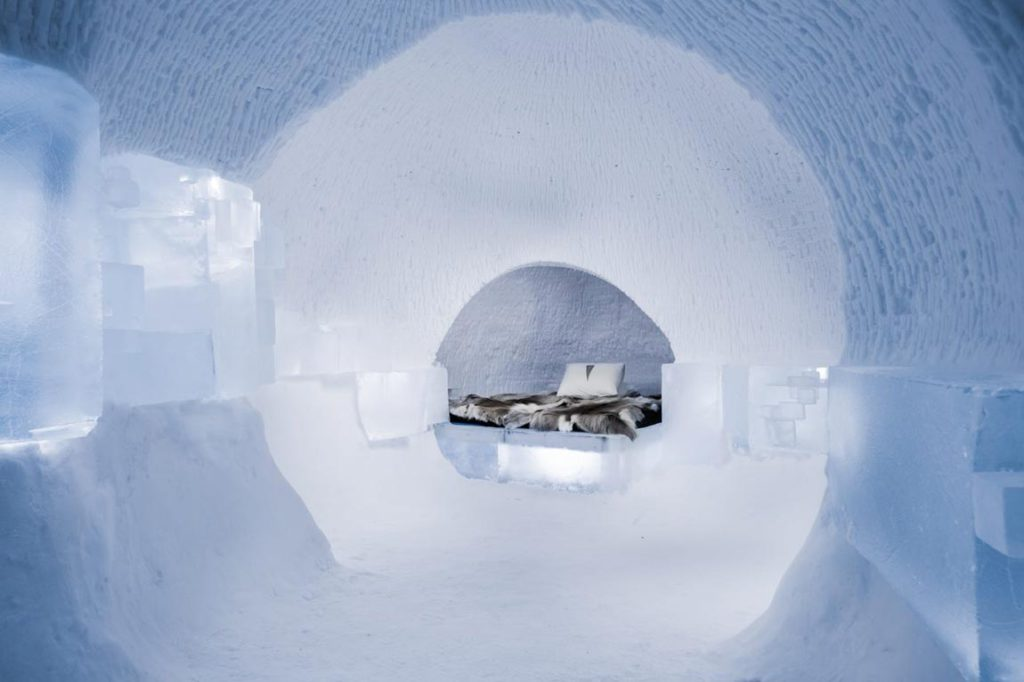 """A Rich Seam"" by by Hugh and Howard Miller suggests digging through a mine to find a seam in the ice, then digging further. This ice hotel room is designed by Hugh and Howard Miller from the UK. Image by Asaf Kliger."
