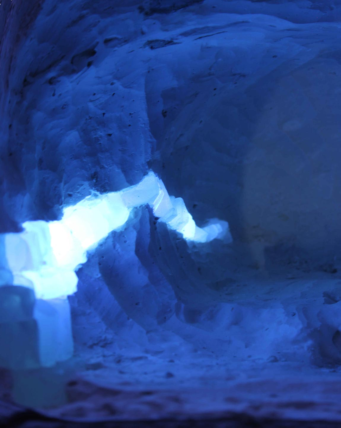 A seam of ice shining through the snow mine at one of the ice hotel rooms, at ICEHOTEL #28.