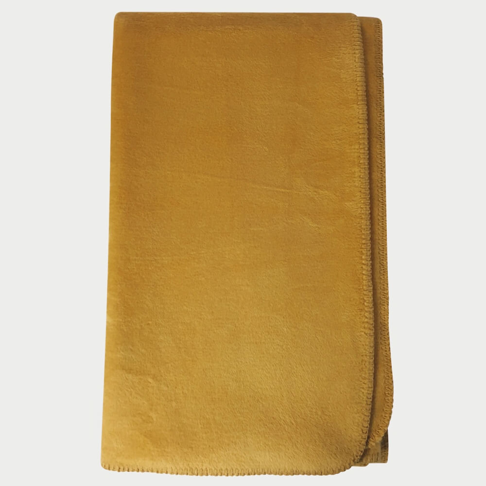 Soft fleece blanket, substantial and huggable. Saffron yellow, 170 x 150cm in cotton/acrylic blend.