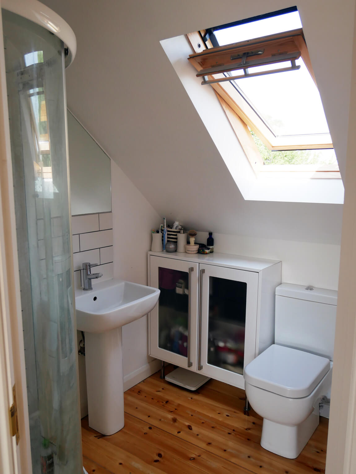 Even the bathroom gives a pleasurable view over the South Downs! The window is large and shoulder height for accessibility.