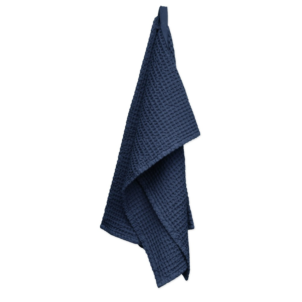 Waffle towels designed by The Organic Company. This soft and absorbent medium sized towel is available in a range of soft colours with a Scandinavian feel. Dark blue seen here.