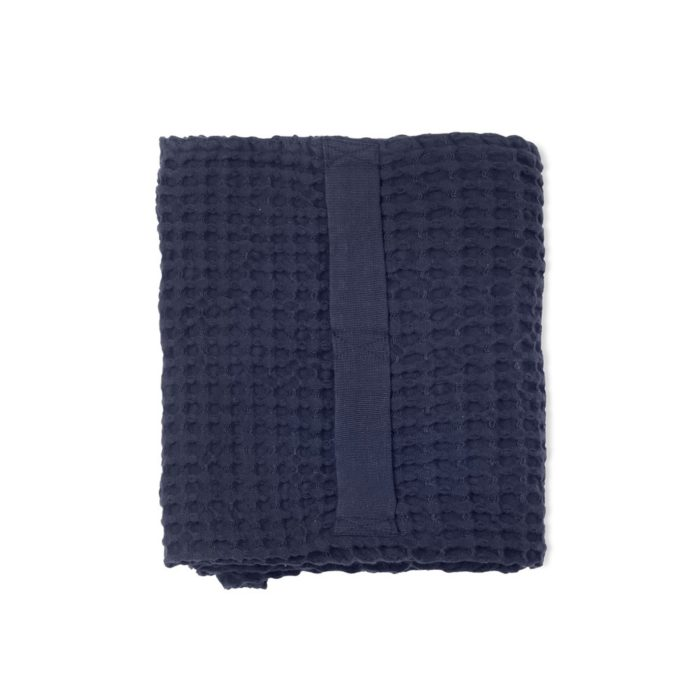 Waffle towels designed by The Organic Company. This soft and absorbent medium sized towel is available in a range of soft colours with a Scandinavian feel. Shown here is dark blue.