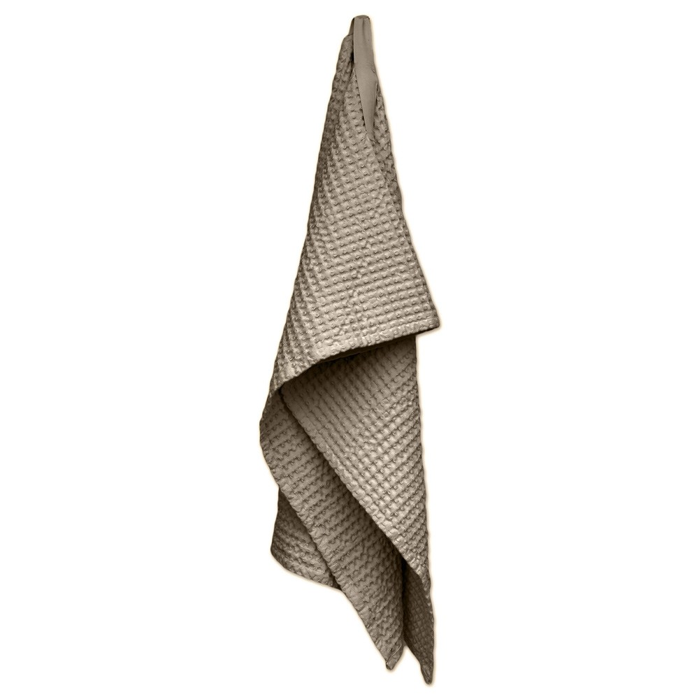 Waffle towels designed by The Organic Company. This soft and absorbent medium sized towel is available in a range of soft colours with a Scandinavian feel. Clay shown here.