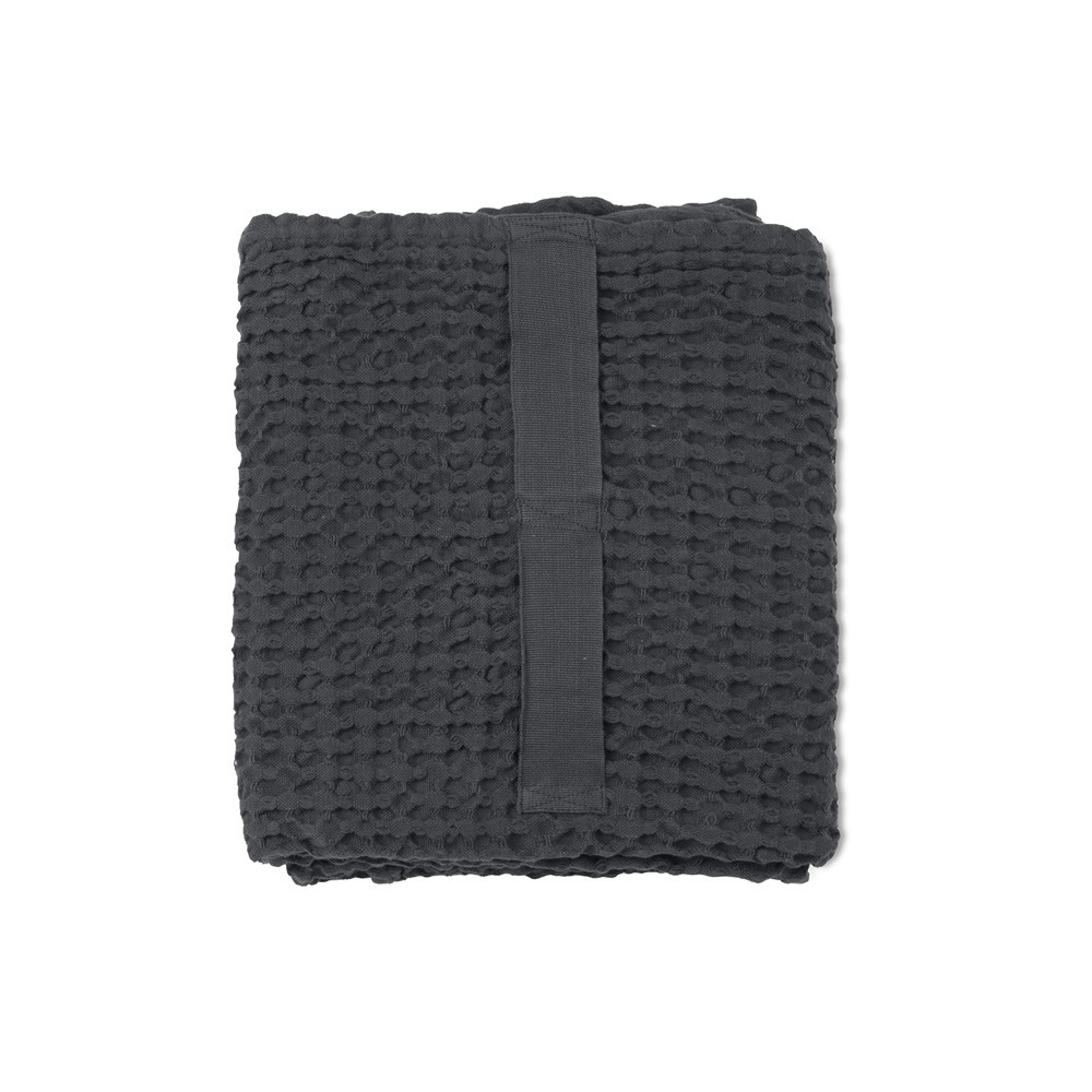 Waffle towels designed by The Organic Company. This soft and absorbent medium sized towel is available in a range of soft colours with a Scandinavian feel. Seen here in dark grey.