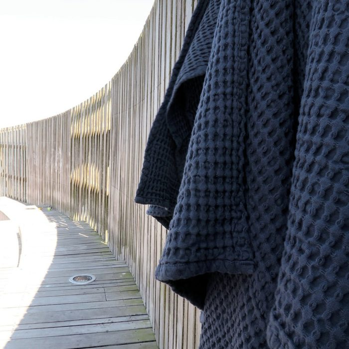 Waffle towels designed by The Organic Company. This soft and absorbent medium sized towel is available in a range of soft colours with a Scandinavian feel. Shown here in blue.