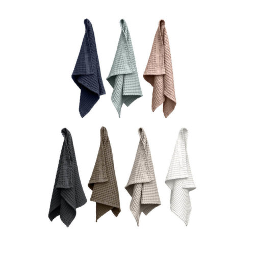 This hand towel by Denmark's The Organic Company is soft and absorbent, making it ideal in bathrooms, guest rooms and the kitchen. The giant waffle texture gives the towel a luxurious and comforting quality. In true Scandinavian style, these ethical towels come in several complimentary colours that look great stacked together (dark grey, white, dark blue, sky blue, clay, pale rose). There's a handy loop for hanging. A practical size at 75 x 50cm. Made from sustainable 100% GOTS certified organic cotton in India.