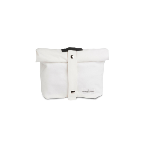 Eco lunch bag in pure cotton canvas by Organic Company on Chalk & Moss. Available in black, natural white and dark blue. Features an adjustable strap. Shown here in white.