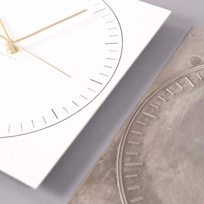 Paper clock in recycled paper, with a sturdy back. By Wald, sold on Chalk & Moss (chalkandmoss.com).