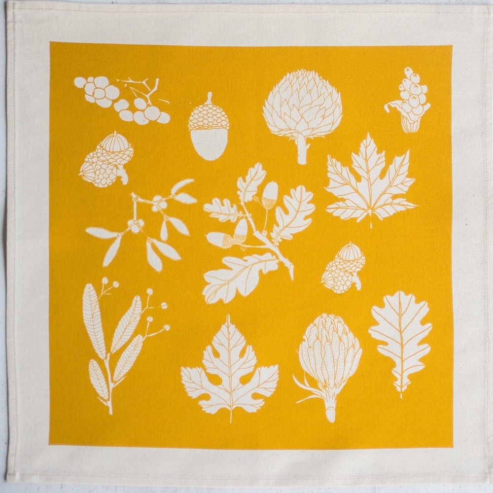 Cotton napkins in winter leaf print - 4 colours available, seen here in vibrant tangerine. By Softer + Wild on Chalk & Moss (chalkandmoss.com).