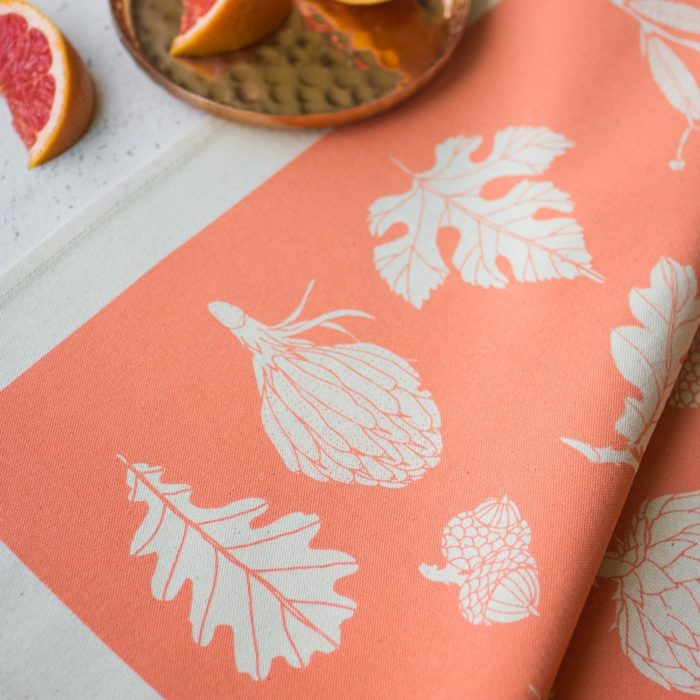 Cotton napkins in winter botanical leaf print - 4 cheerful colours available, here in peach. By Softer + Wild on Chalk & Moss (chalkandmoss.com).