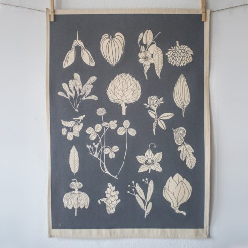 Botanical tea towel in natural, un-dyed cotton by Softer + Wild. Hand screen printed in Sussex UK. Available in many vibrant colours, seen here in charcoal. Available at Chalk & Moss - chalkandmoss.com
