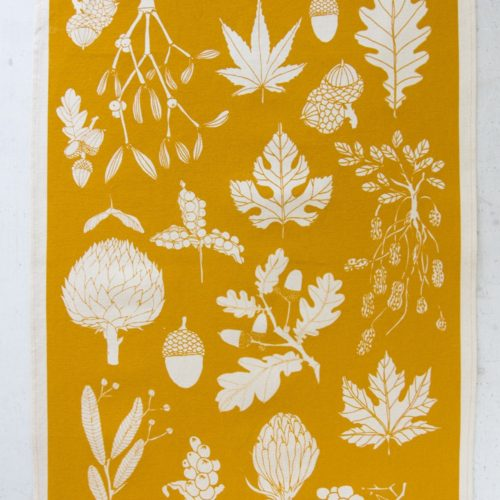 mustard tea towel in winter leaf botanical print. Screen printed in Sussex, UK.