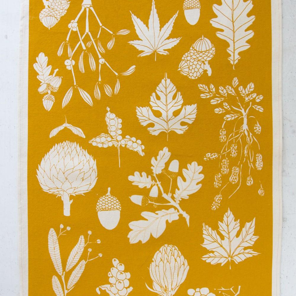 mustard tea towel in winter leaf botanical print. Screen printed in Sussex, UK.