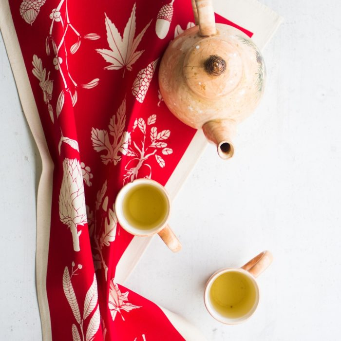 Winter tea towel in Poppy Red, by Softer + Wild, sold on Chalk & Moss. This design is available in several vibrant colours.