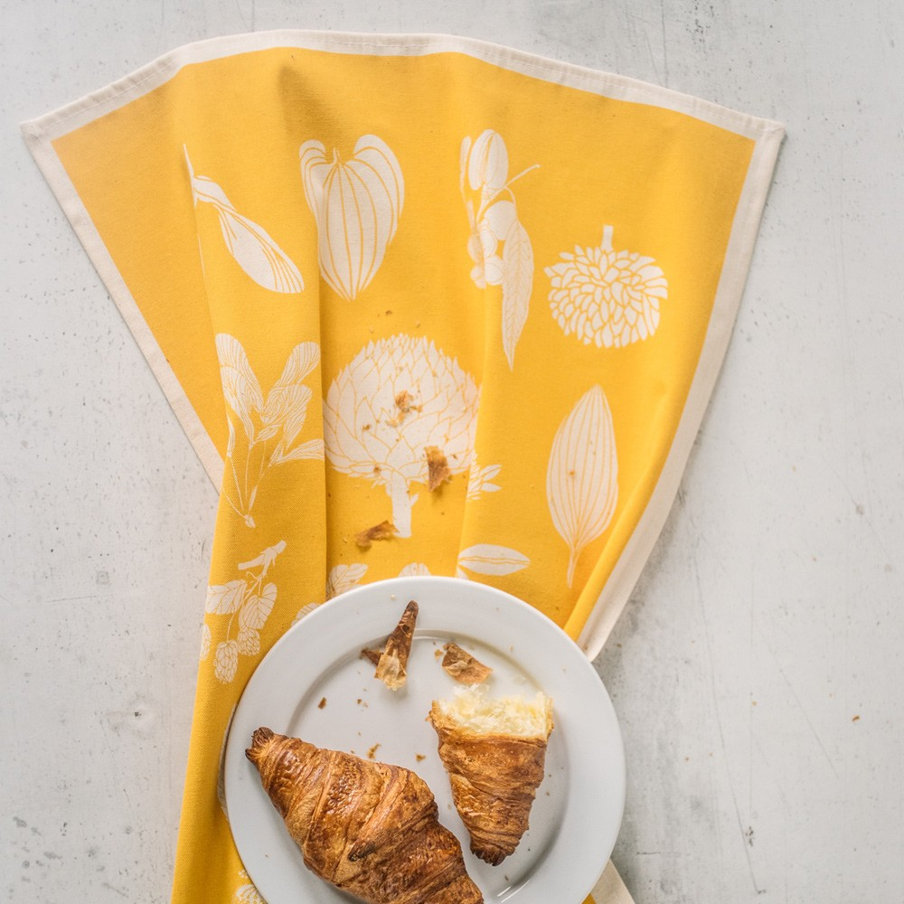 Botanical tea towel in natural, un-dyed cotton by Softer + Wild. Hand screen printed in Sussex UK. Available in many vibrant colours, seen here in sunflower yellow. Available at Chalk & Moss - chalkandmoss.com
