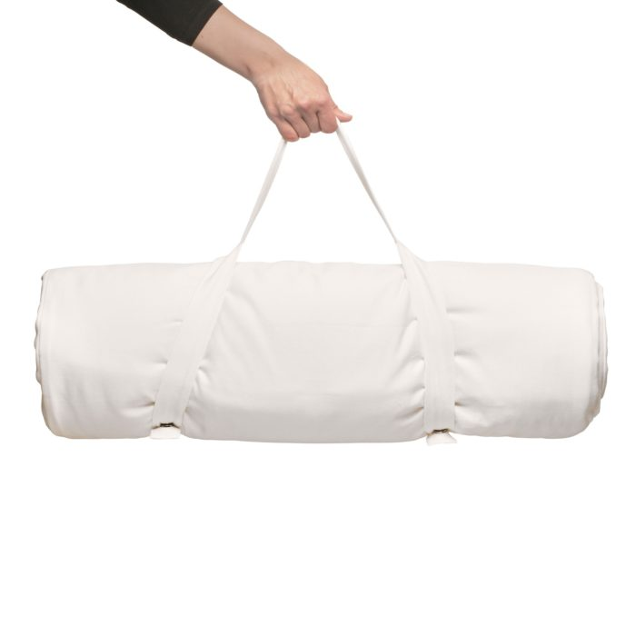 White meditation mat with carry handle. GOTS certified organic cotton throughout. Shown in white, other colours available on Chalk & Moss.