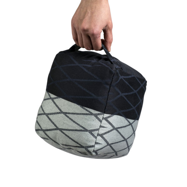 Meditation cushion in GOTS certified organic cotton. A tool to help you keep an upright posture during your meditating. 20 x 20 x 16cm. Shown here in grey and black. Find this and other wellness products by The Organic Company on nature connected homeware store Chalk & Moss (chalkandmoss).