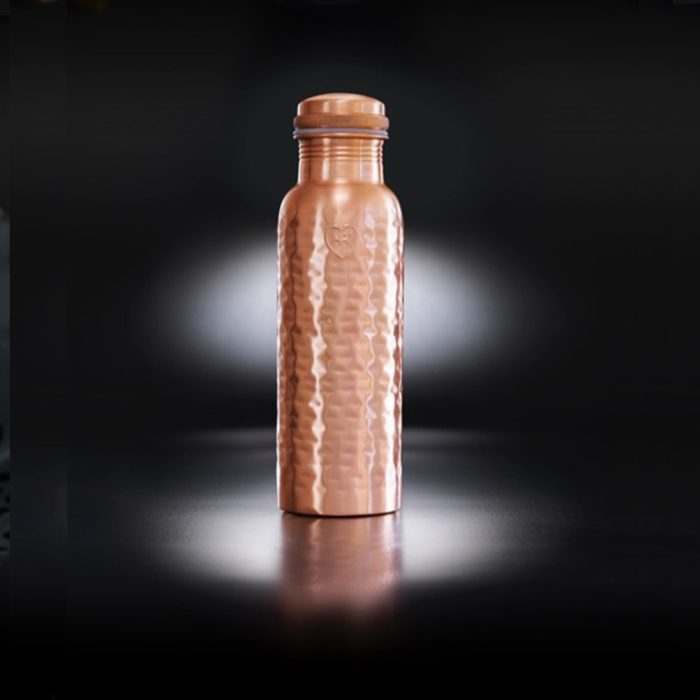 Copper water bottle in hammered matte copper. The ion charged water from this bottle can help ease digestive ailments and sore joints, protect you from sun damage and keep your skin youthful by helping cells regenerate, and much more! This is the Athlete model with a wide mouth and 850ml capacity.