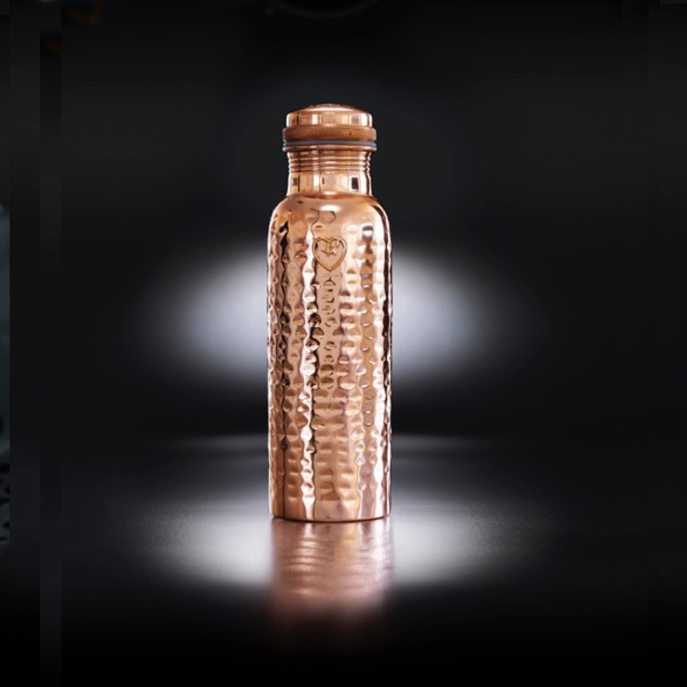 "Copper water bottle with health benefits including antioxidant, anti-inflammatory and anti-microbial properties. The Yogibeings bottles on chalkandmoss.com come in different variations, this one is the polished hammered copper ""Athlete"" bottle (850ml)."
