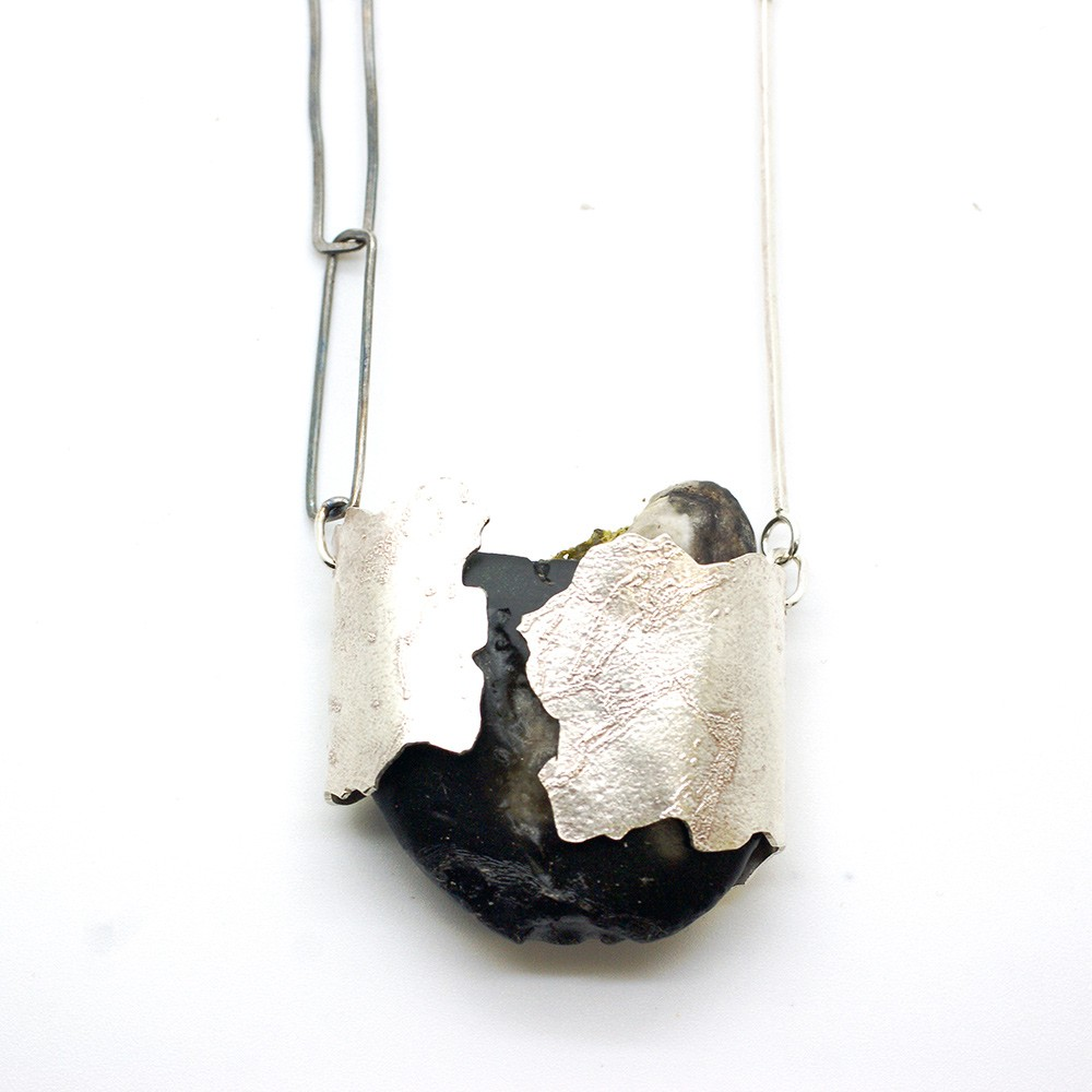 Long pendant silver necklace that comes with three individual, one of a kind inserts. The inserts are made from stone and resin, resulting in a new deep sea creation. Made from 925 silver. Chain: 74 cm Pendant: 40mm x 40mm x 15mm
