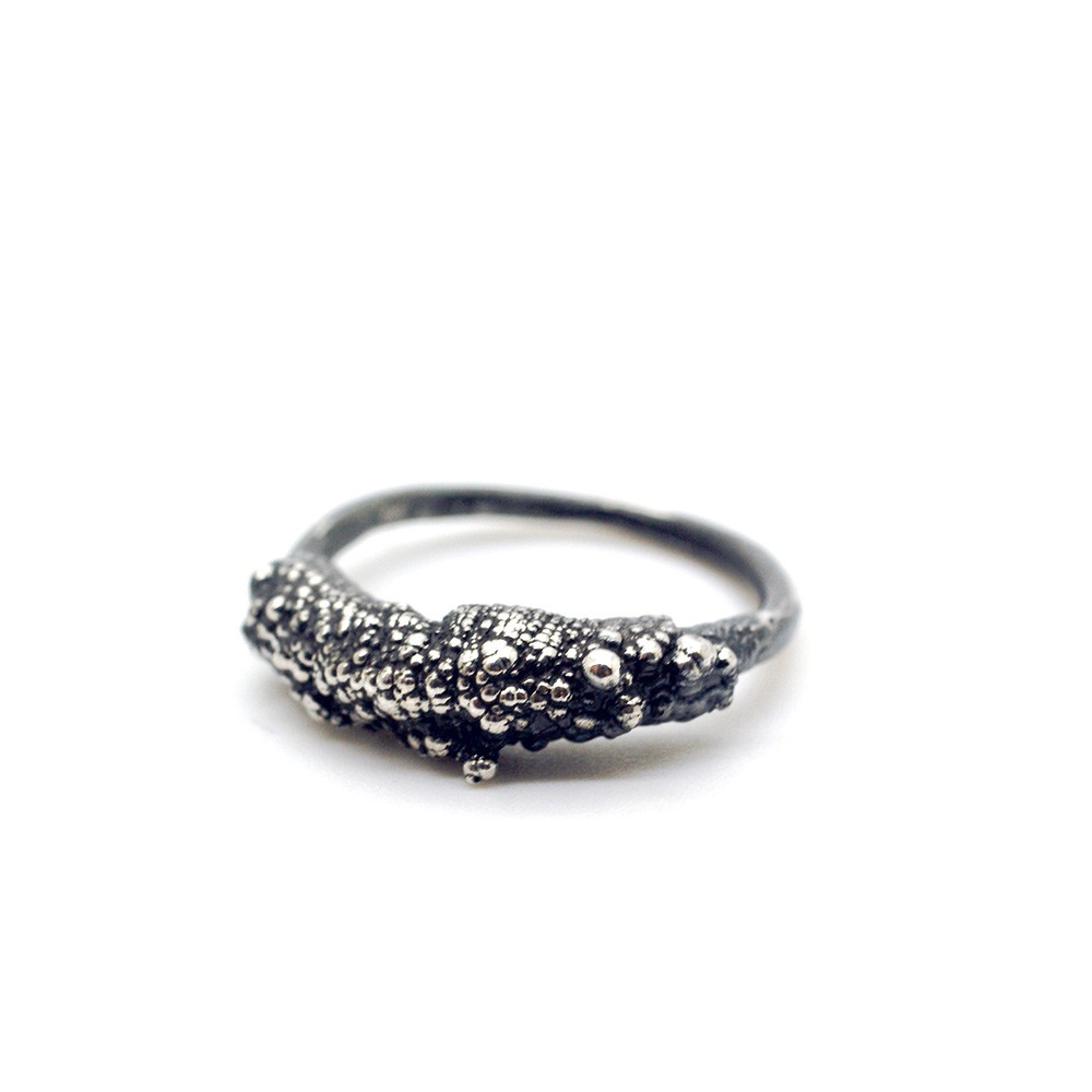 Chunky silver ring (Style 3) made by electroforming, with knobbly formations created by electrical currents in the making process. Heavy texture on the top half of the ring define the Style 3 ring. Made from 925 silver.