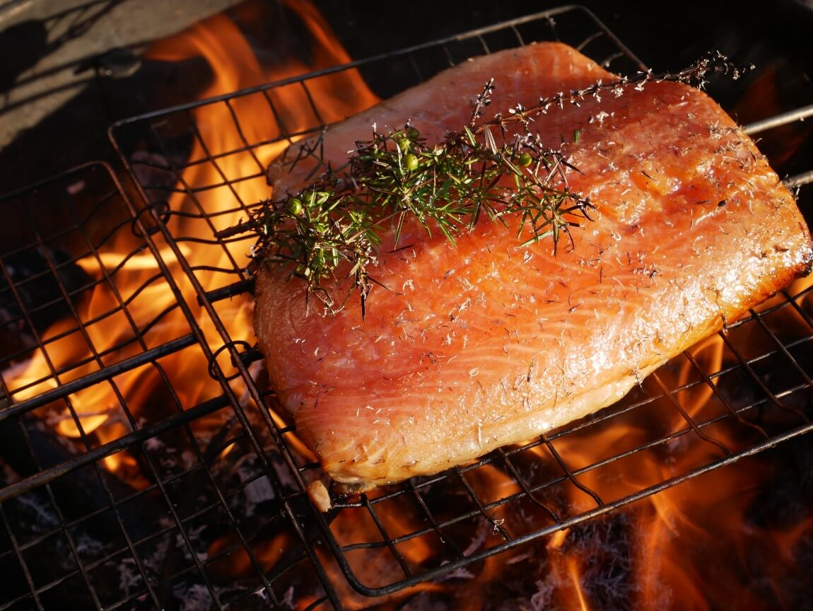 Hot smoked salmon with juniper. Looking for salmon recipes? I highly recommend this one. The salmon is hot smoked directly onto flames and juniper bushes. The ash creates a beautiful smoky flavour. I followed the recipe from Niklas Ekstedt in Food from the Fire.