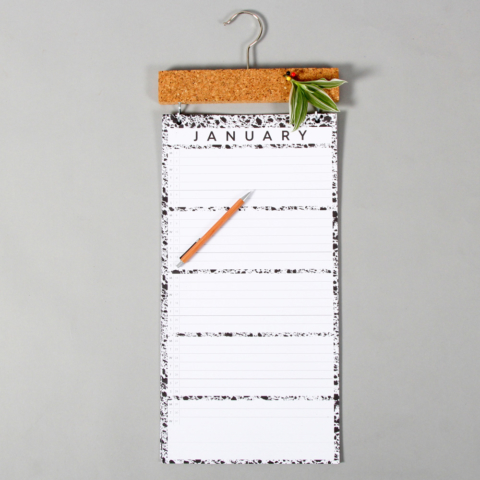 Large wall calendar with a month to view and a practical cork strip for pinning important notes. Get your family organised with this simple monochrome design. W23 x H57 x D2 cm