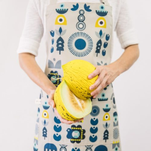 "Cooking apron combining Scandinavian shapes and colours with Eastern European folklore. Inspired by retro Christmas tree baubles. Available in two colours. This is the ""Solstice"" design. 60cm X 80cm."
