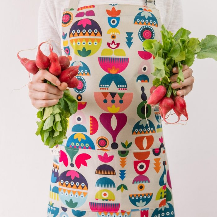 "Cooking apron combining Scandinavian shapes and colours with Eastern European folklore. Inspired by retro Christmas tree baubles. Available in two colours. This is the ""Bright"" design. 60cm X 80cm."