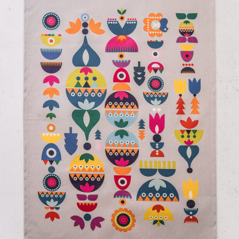 """Two designs inspired by Scandinavian and Eastern European folklore in a '70s style. These make beautiful and alternative Christmas tea towels. This is the """"Bright"""" design. Also available in a blue """"Solstice"""" design. 70 x 50cm."""