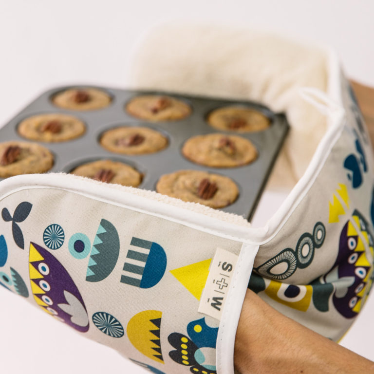 """Solstice double oven glove inspired by Scandinavian 1970s shapes and Eastern European patterns. 84x20cm. 100% cotton with towelling back, heat resistant. Available in two colour ways. This is the """"Solstice"""" design."""