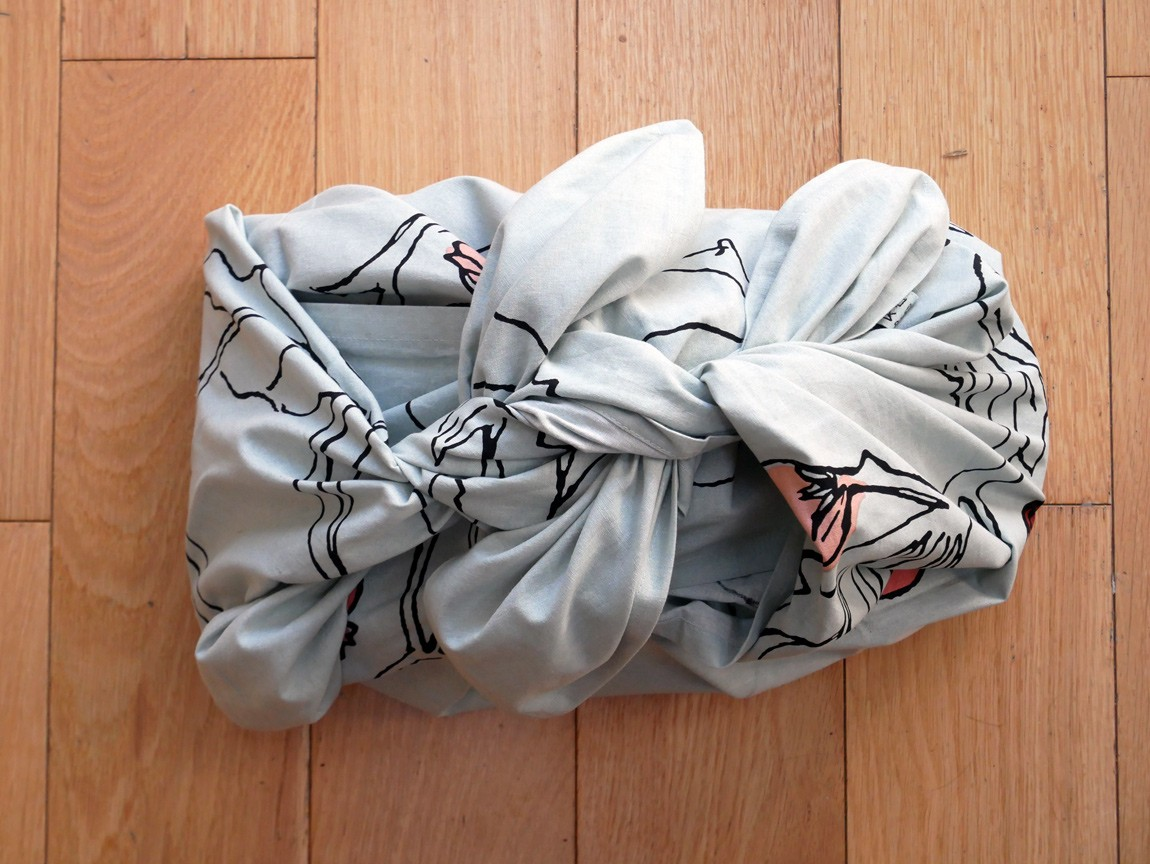 This year, give yourself a break from fighting with sellotape and paper that won't cut or fold evenly. Instead, make an eco friendly, beautiful, simple and quick Furoshiki wrap. A beautiful wrap can be a gift in itself.