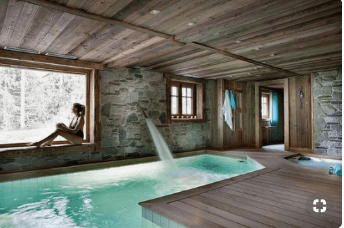 Luxury Ski Chalets Ferme Anjuna, Megeve, France. Presence of water plays an important role in nature connected, biophilic design. This can be still or moving water, such as a water feature.
