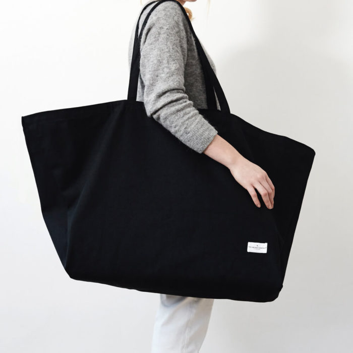 Extra large organic cotton canvas overnight bag, weekend bag or day bag. Lightweight enough to carry around with you. Seen here in black (also available in clay, dark blue and stone grey).