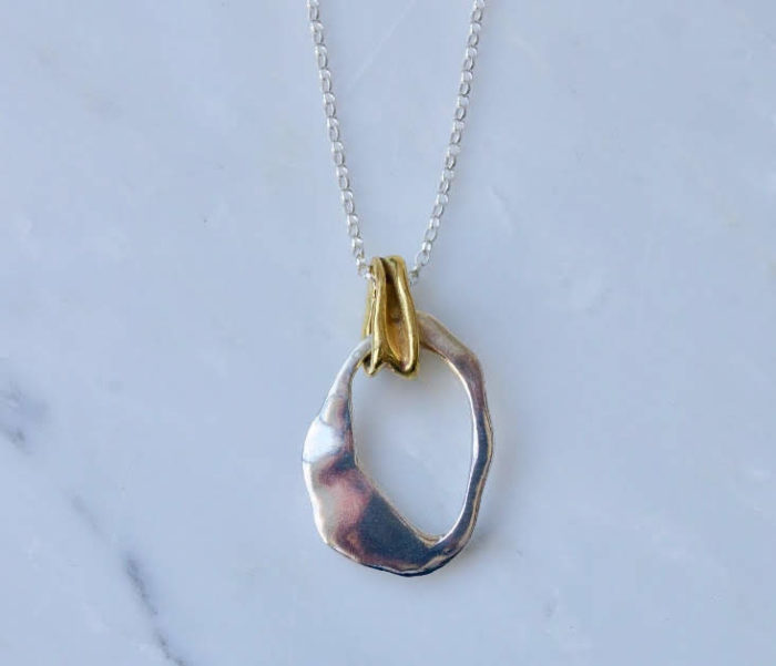 Recycled jewellery: silver and brass pendant, inspired by the ocean. Part of the Ocean Plastic collection by Emma Aitchison. Comes with a 300mm chain.