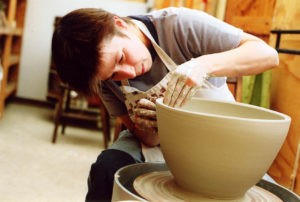 Linda Bloomfield at her pottery wheel in her West London studio.