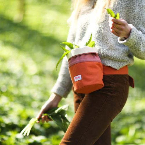Foraging bag - Bric - orange & pink - lifestyle image wild garlic