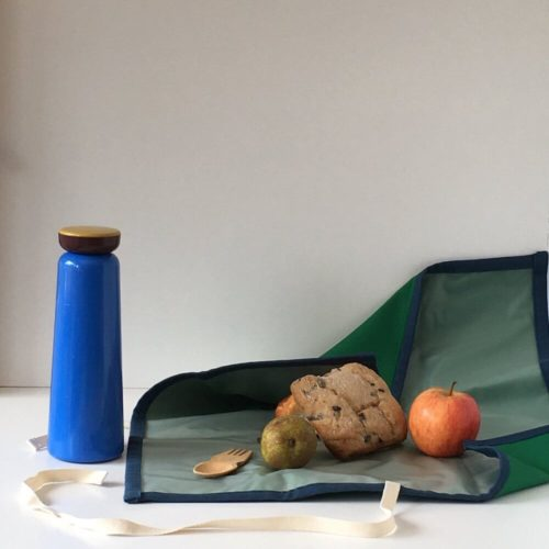 Bric reusable sandwich wrap with a BPA free waterproof, wipe clean lining. Durable cotton canvas shell in beautiful earthy colours, with a strap. Dimensions: H 47cm x W 44cm Choice of forest green, petrol blue and gorse yellow. Seen here in forest green.