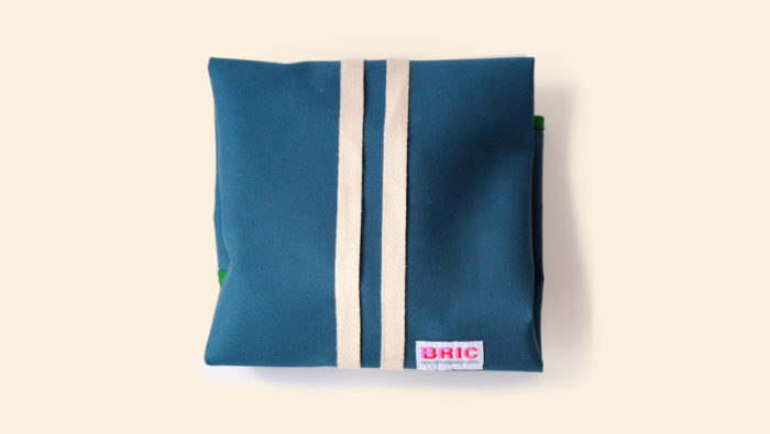 Bric reusable sandwich wrap with a BPA free waterproof, wipe clean lining. Durable cotton canvas shell in beautiful earthy colours, with a strap. Dimensions: H 47cm x W 44cm Choice of forest green, petrol blue and gorse yellow. Seen here wrapped up, in petrol blue.