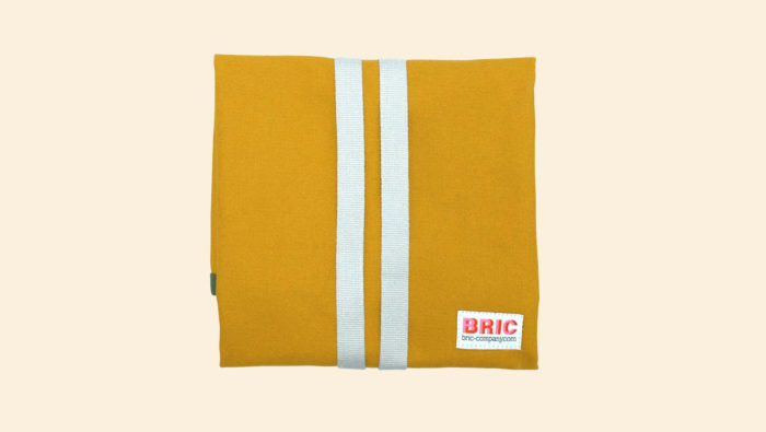 Bric reusable sandwich wrap with a BPA free waterproof, wipe clean lining. Durable cotton canvas shell in beautiful earthy colours, with a strap. Dimensions: H 47cm x W 44cm Choice of forest green, petrol blue and gorse yellow. Seen here wrapped up, in gorse yellow.